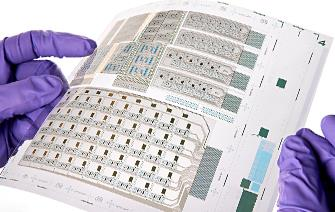 Printed electronics: Transistors scaled up to system-level prototypes